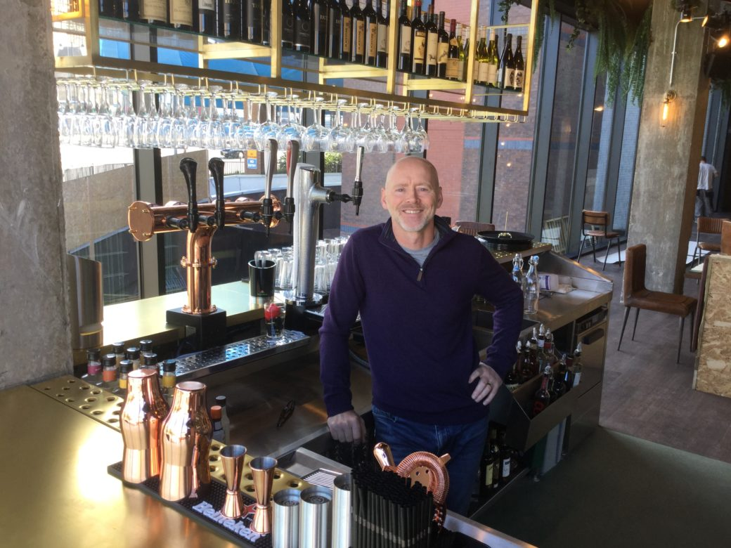 Kevin Fearon behind the bar of the brand new, Liverpool city eaterie The Courtyard Bar & Kitchen